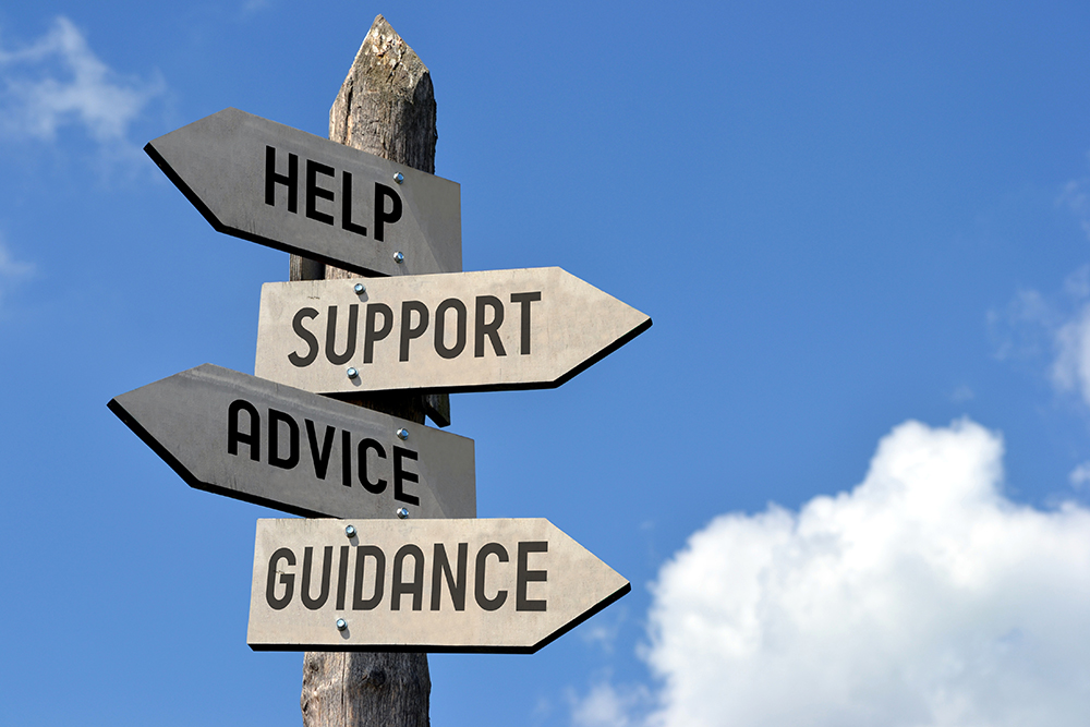 Sign post with help, support, advice and guidance