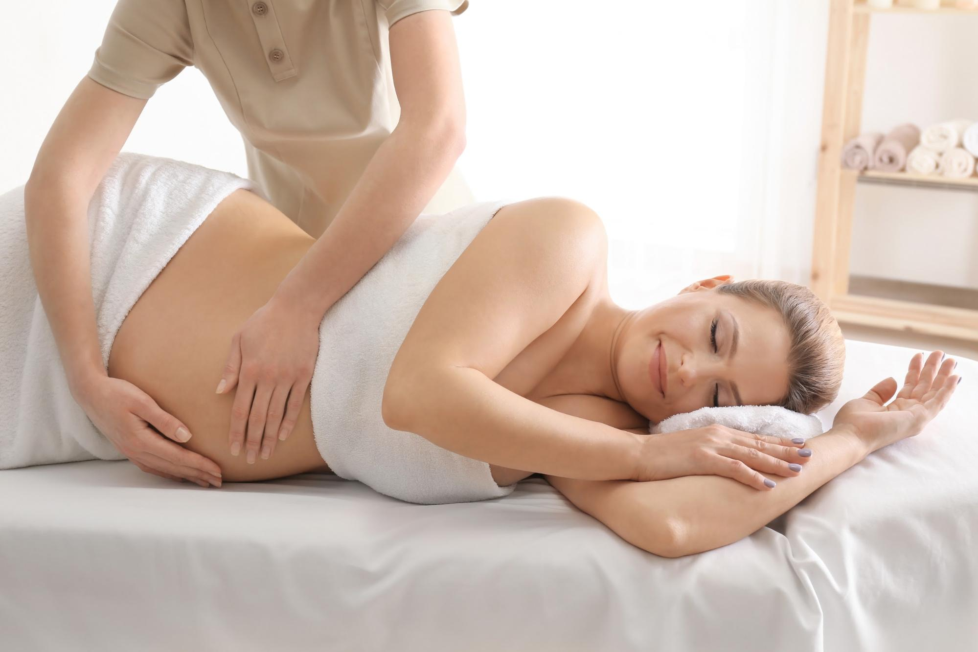 Pregnant woman getting massaged at Acubalance